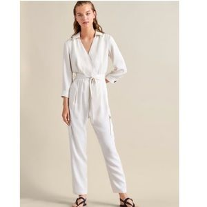 Wrap cargo jumpsuit with pockets. NWT